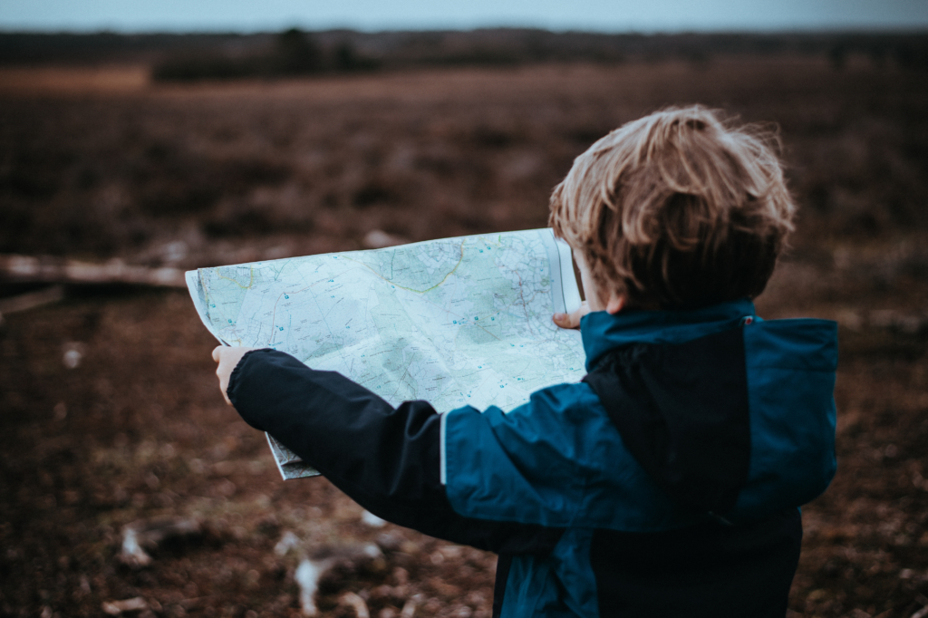 Like this little boy reading a map, kids need to understand the lesson's learning objective if they stand any chance of staying on course in their learning.