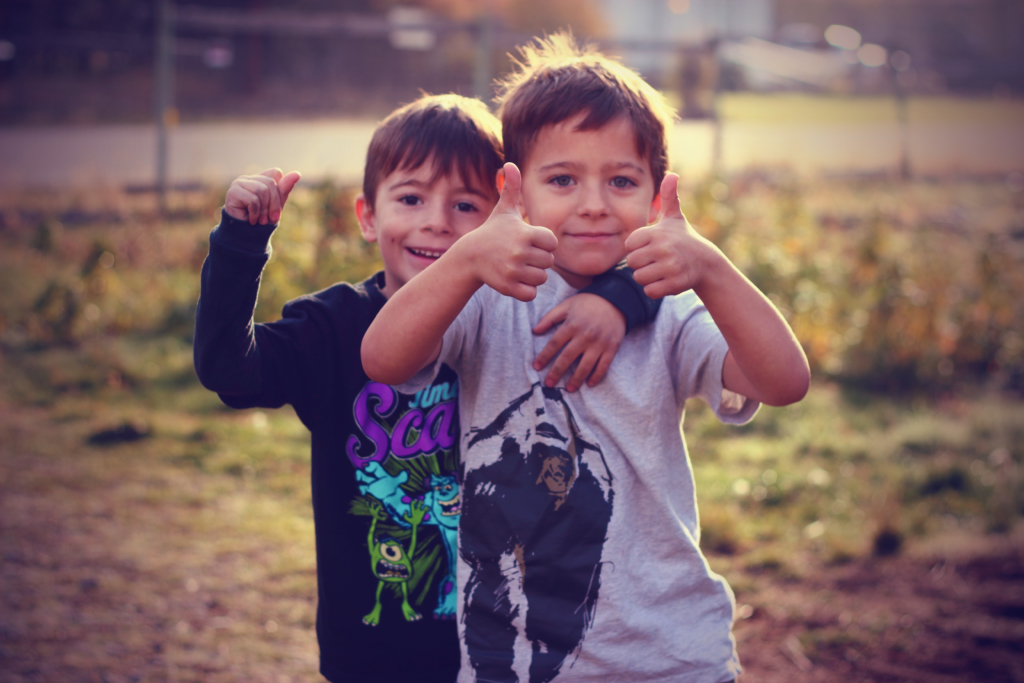 These two boys give thumbs up. This is what I have my students do in my classroom if they feel like they have sufficiently met the learning objective.