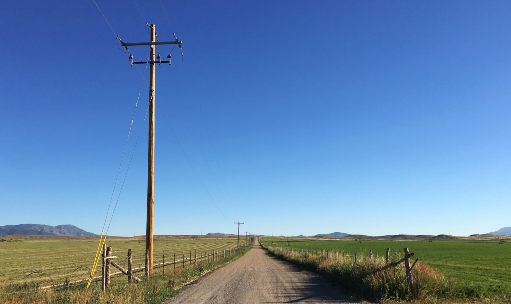 The telephone poles leading down a road symbolize how learning objectives should be doable pitstops on the way to the larger goal.
