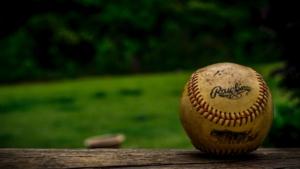 A baseball against an open field.