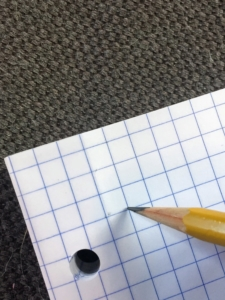 Counting four boxes down on the graph paper lets students know where to begin writing.