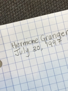 Students write their name and the date neatly as an organizational study skill.