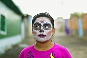 When students can celebrate their holidays, such as this girl celebrating Dia de los Muertes, the diversity in the classroom is strengthened.